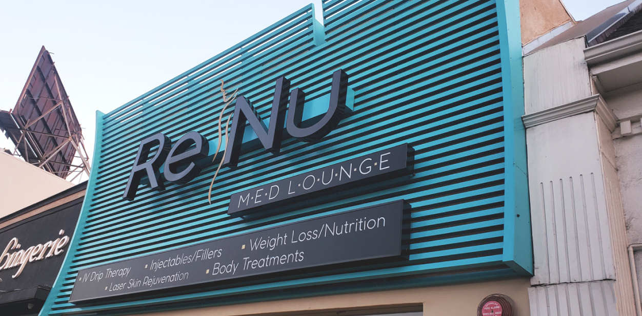 Renu medical clinic branding signs displaying the company name and services