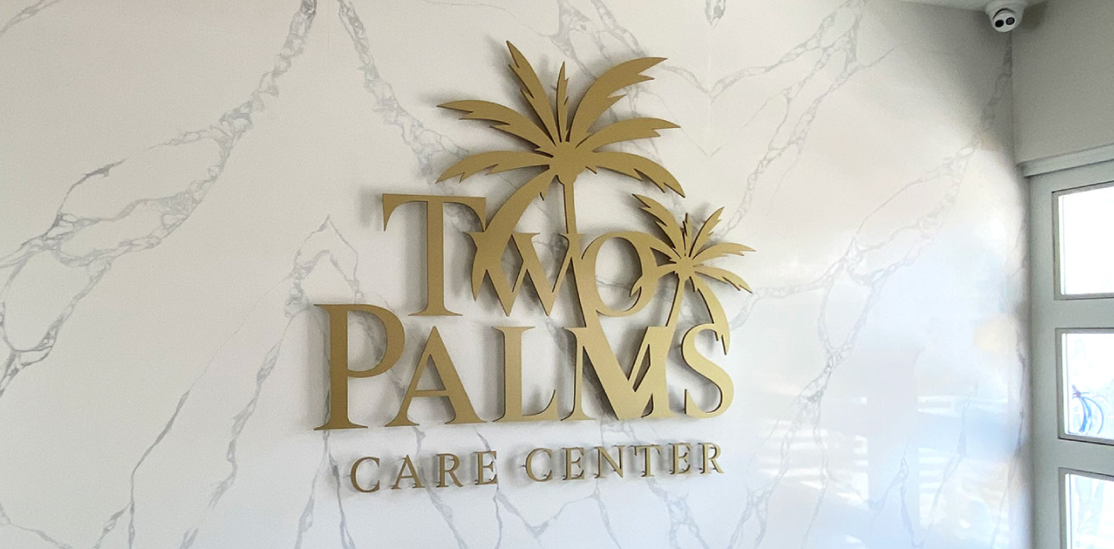 Two Palms Care Center medical clinic decoration sign in golden color