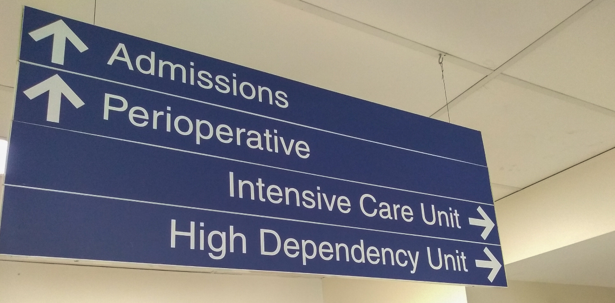 Hanging medical clinic directional display in blue