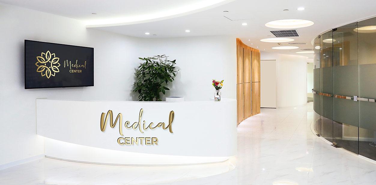 Elegant medical office reception design idea in white, black and golden colors