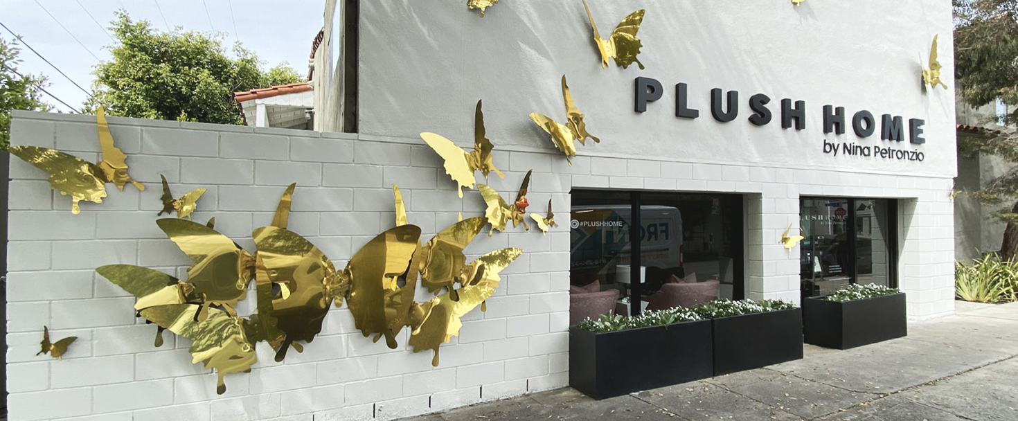 Plush Home custom outdoor sign with golden butterflies made of aluminum for building branding