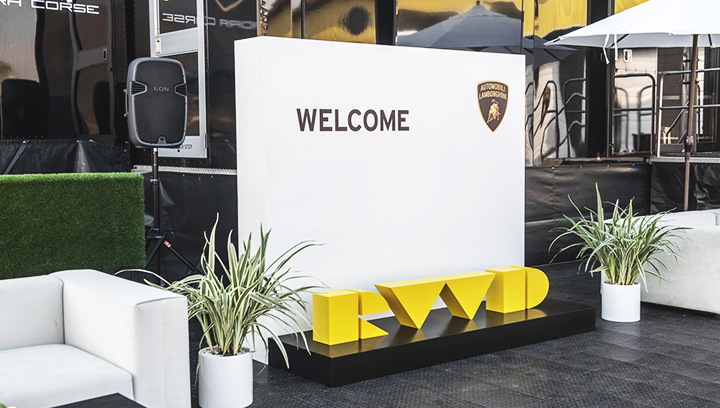 Lamborghini custom outdoor event sign with the brand name and logo made of aluminum and wood