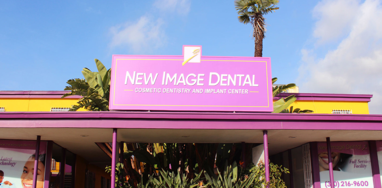 New Image Dental outdoor medical office sign in pink and white