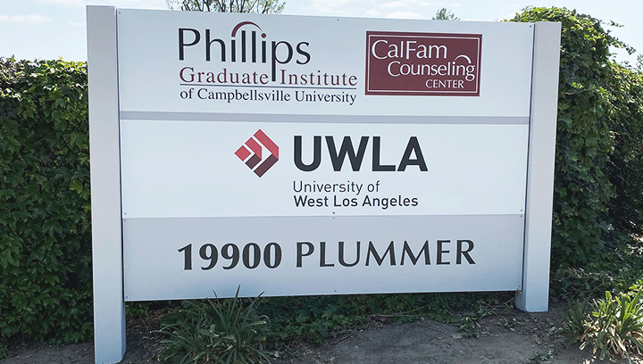 University of West Los Angeles outdoor monument sign made of plywood