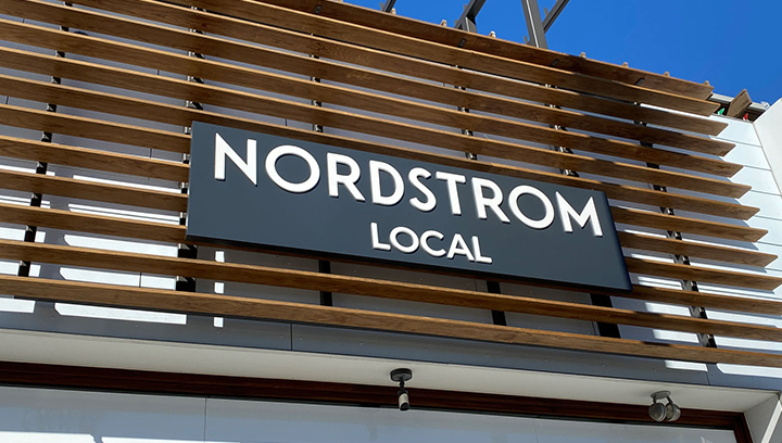 Nordstrom Local exterior sign made of aluminum and acrylic for storefront branding