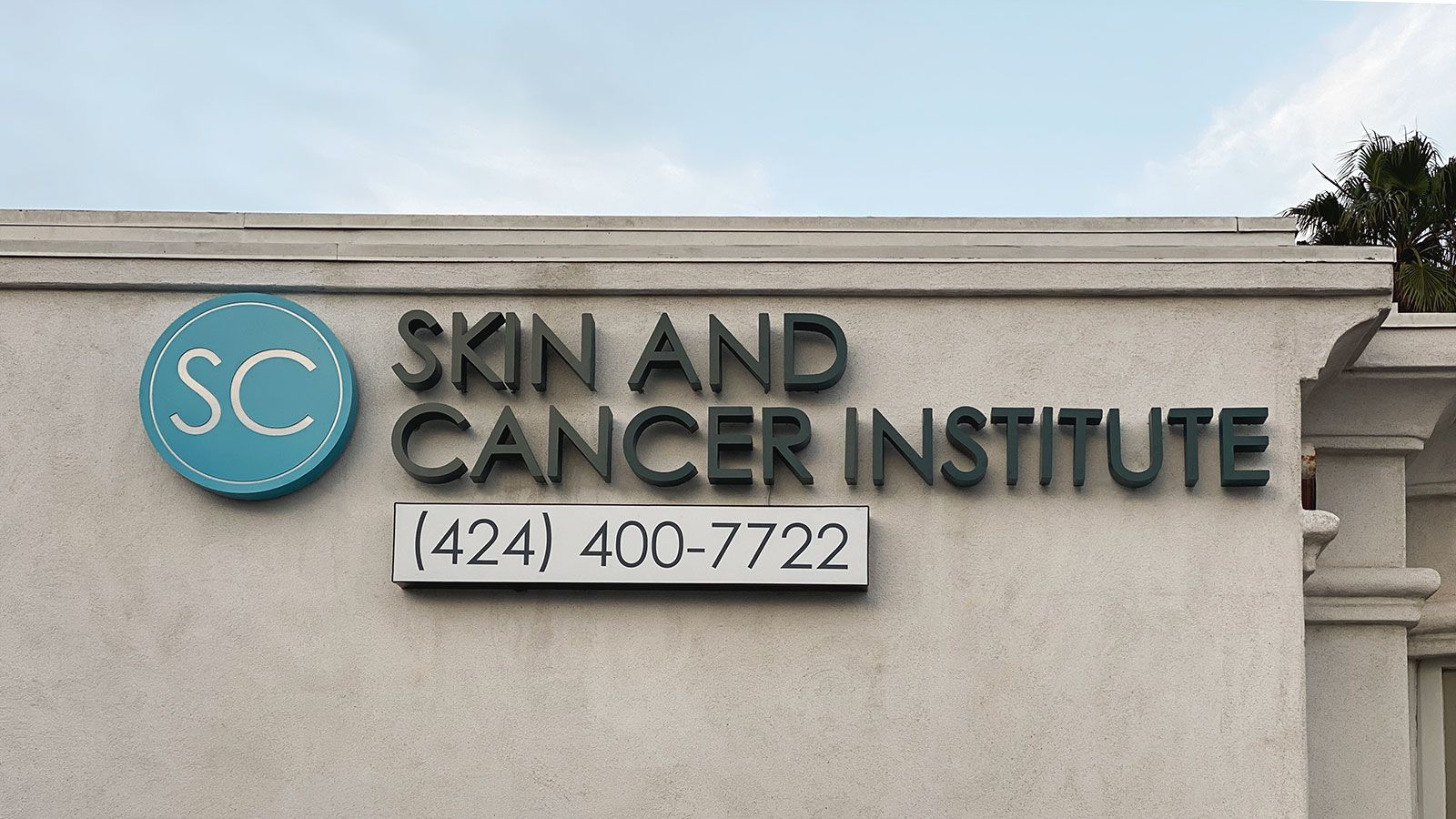 skin and cancer institute building sign