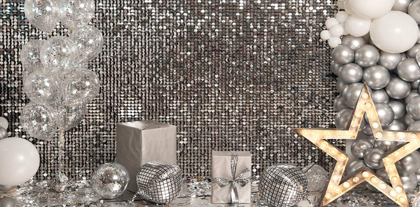 Party sequin wall backdrop in silver color with decorative balloons