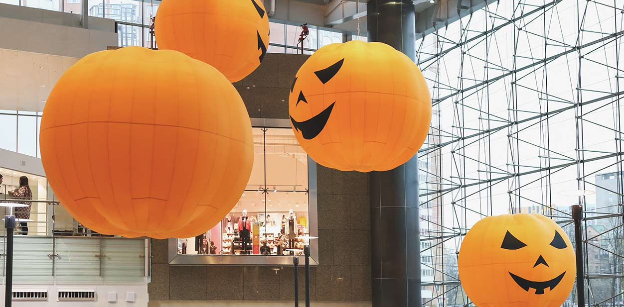 Custom Halloween retail signs in the form of large hanging pumpkins