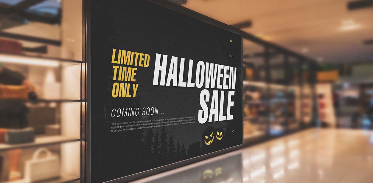 Black Halloween retail sign displaying upcoming Sales