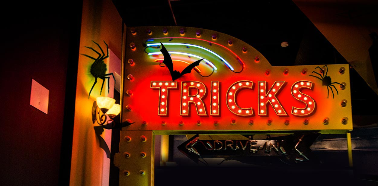 Lighted Halloween sign displaying the word Tricks