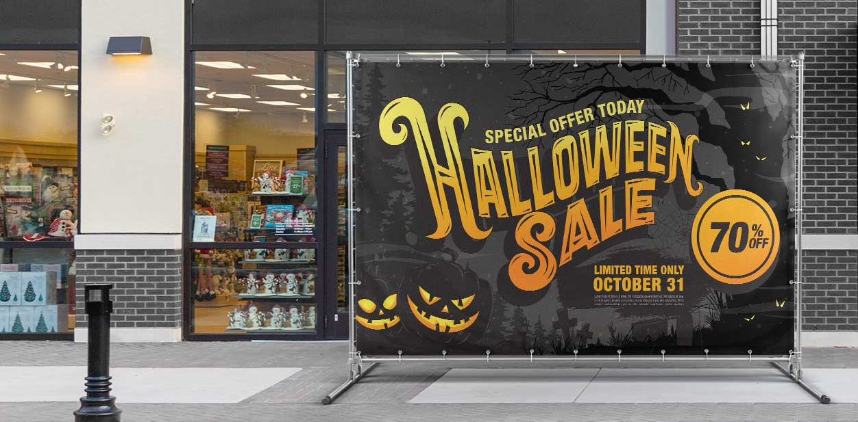 Large promotional Halloween backdrop in black placed at the storefront