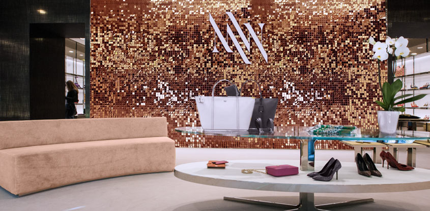 Large sequin wall in golden color for store interior design